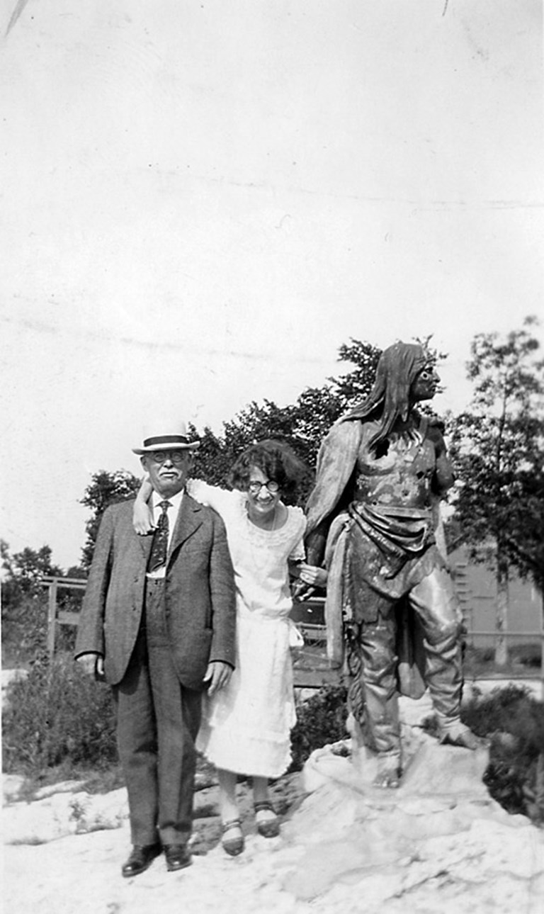 Man, Woman, and Indian Statue