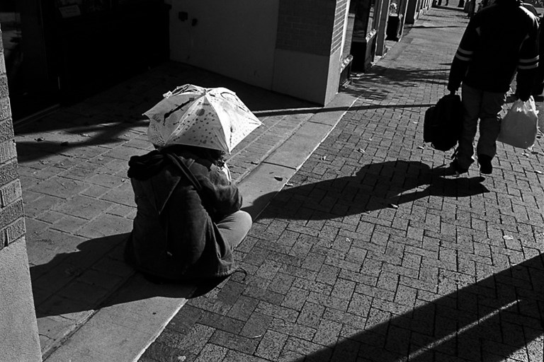Woman and child with umbrella, 2008