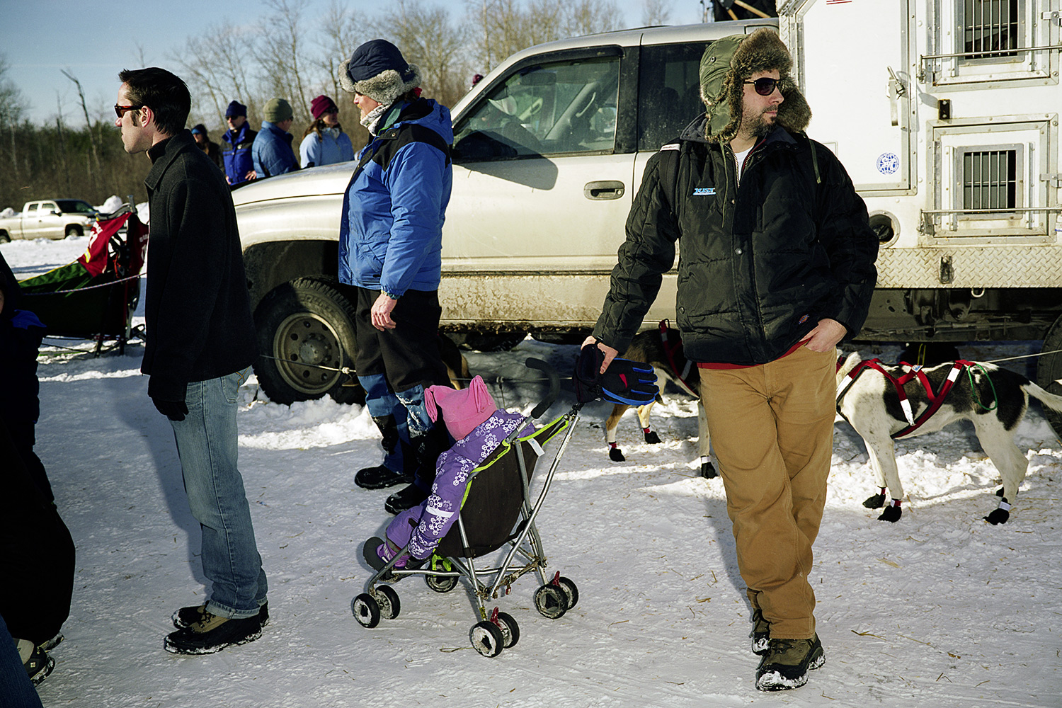 A Man Waits With A Child In A Stroller, January 2011