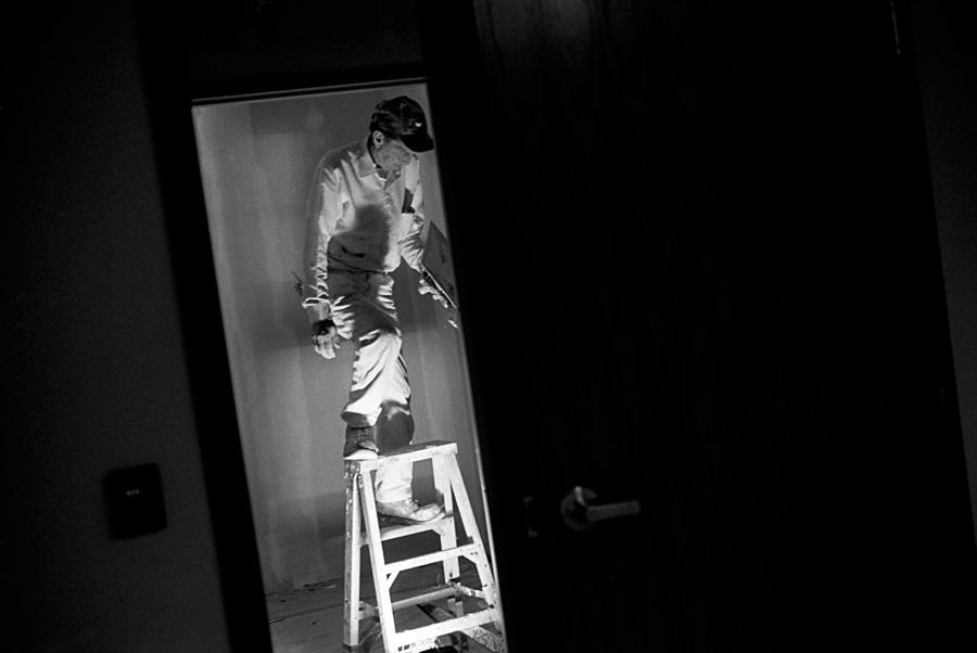 A Man Uses a Step Ladder