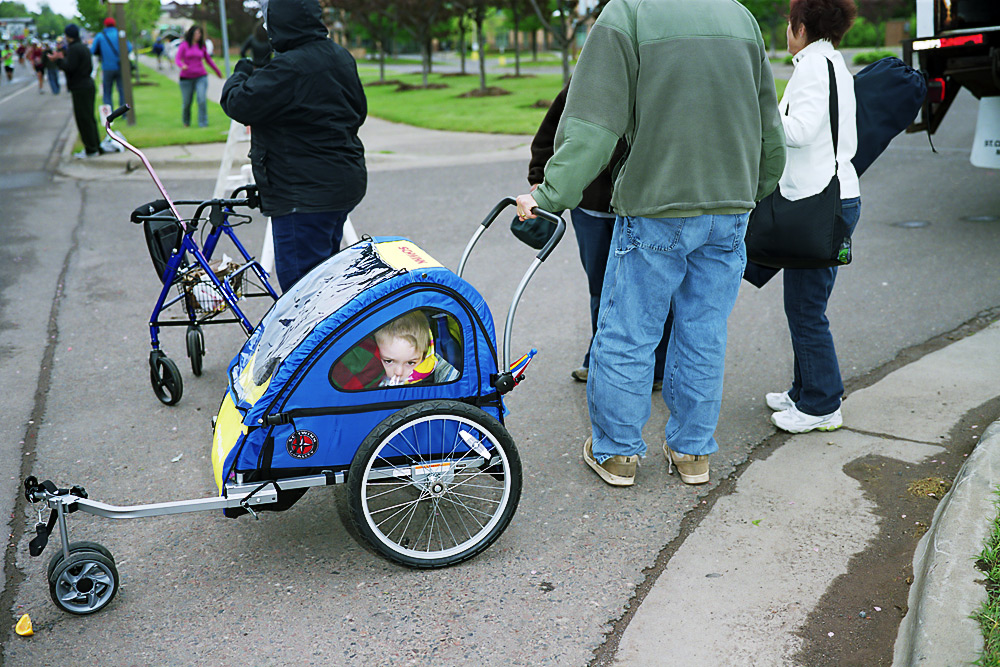 A Child Packed Into A Stroller
