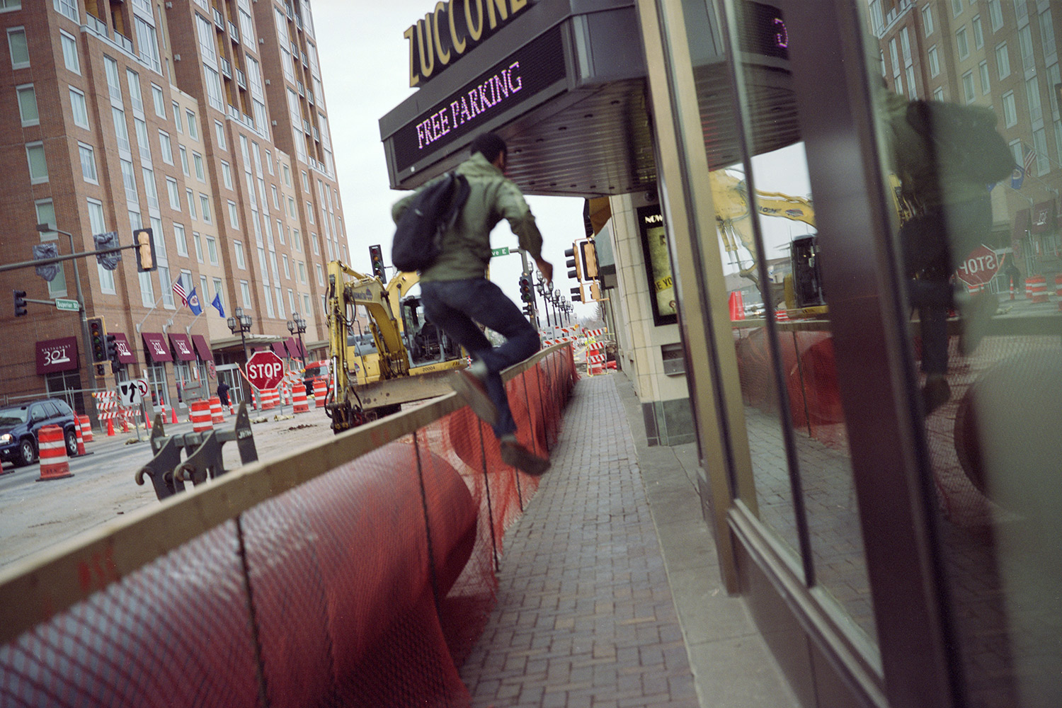 Man Leaping Over A Construction Barricade, Duluth, Minnesota, May 2011