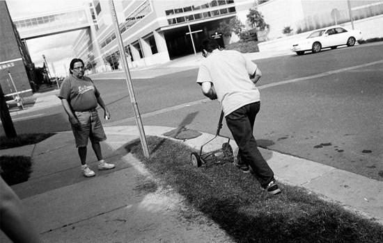 A Man Mows Some Grass