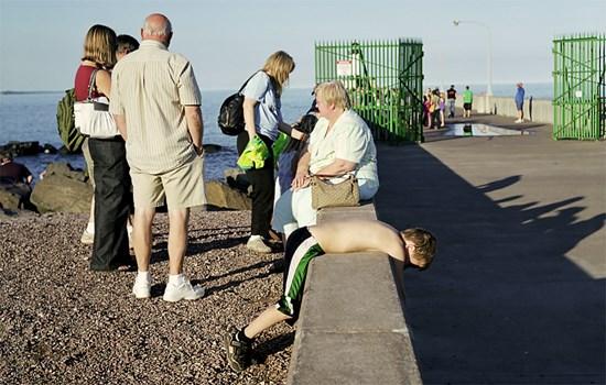 A Boy Lays On A Ledge, Duluth, Minnesota, August 2010