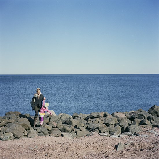 Helping a Child Over The Rocks, Duluth, Minnesota, March, 2010