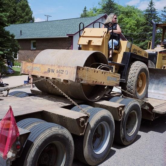 Woman On A Steamroller On A Trailer, Birnamwood, Wisconsin, June, 2010