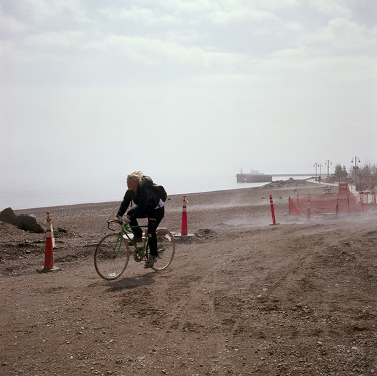 Bicyclist On The Lakewalk, Duluth, Minnesota, April, 2010