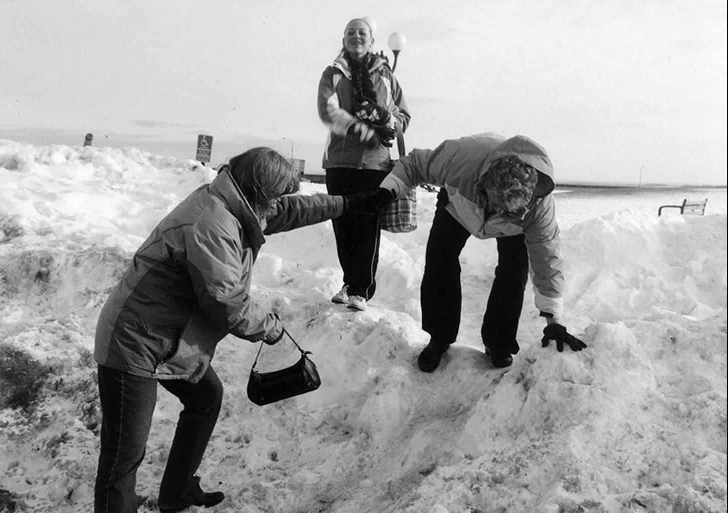Climbing a snowbank to reach a parking lot, Duluth, Minnesota, January 2008