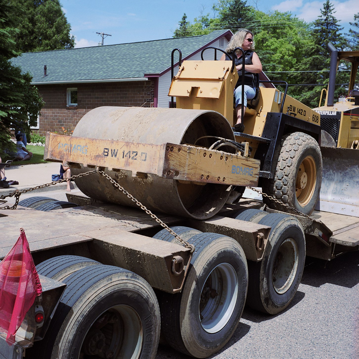 Woman On A Steamroller On A Trailer, Birnamwood, Wisconsin, June 2010