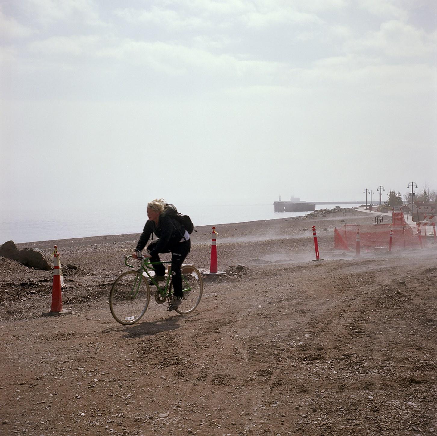 Bicyclist On The Lakewalk, Duluth, Minnesota, April 2010
