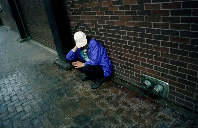 A Man in a Purple Coat