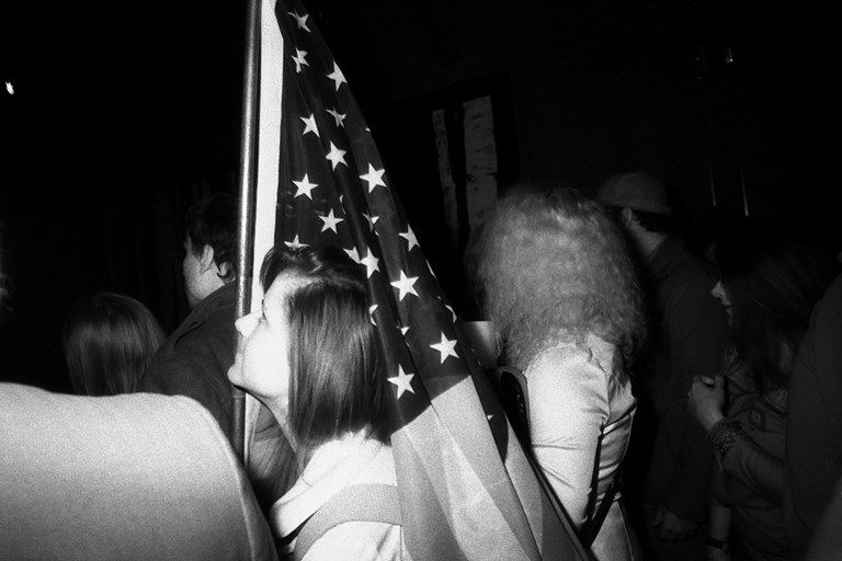 Woman Bearing an American Flag, April, 2013