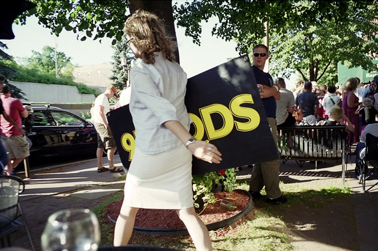 Woman With A KQDS Sign, Duluth, Minnesota, June, 2010