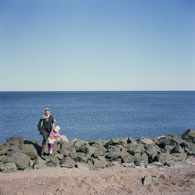 Helping a Child Over The Rocks, Duluth, Minnesota, March 2010
