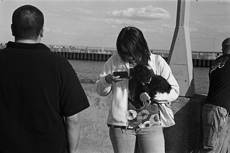 Texting Woman With a Dog , Duluth, Minnesota, May 2008