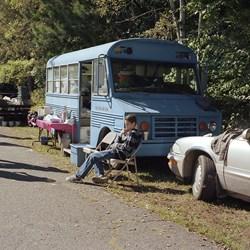 Boy By A Blue Bus