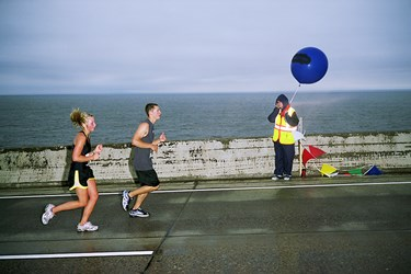 Two Runners And A Man With A Balloon