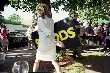 Woman With A KQDS Sign