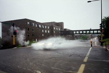 SUV Drives Through Rainwater